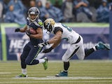 Punt returner Golden Tate #81 of the Seattle Seahawks rushes against Clay Harbor #86 of the Jacksonville Jaguars at CenturyLink Field on September 22, 2013