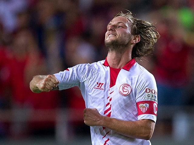Sevilla's Ivan Rakitic celebrates after scoring his team's second goal against Rayo Vallecano during their La Liga match on September 25, 2013