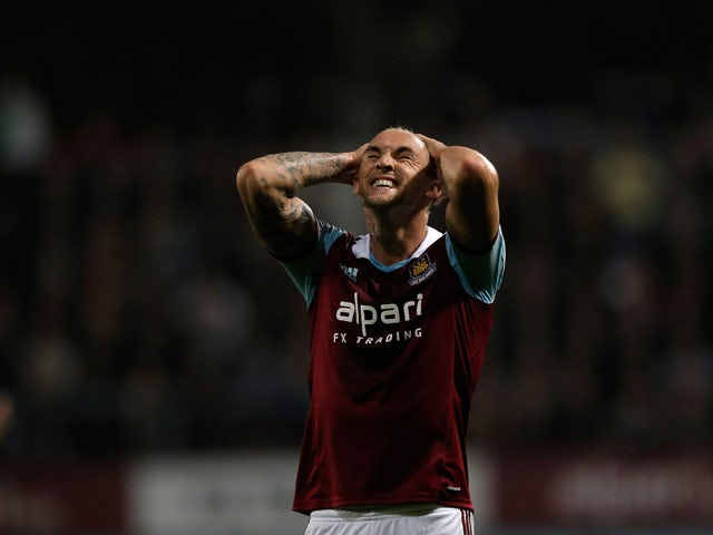 Jack Collison of West Ham reacts during the Capital One Cup third round match between West Ham United and Cardiff City at the Boleyn Ground on September 24, 2013
