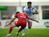 Racing's British centre Jamie Roberts tries to avoid the tackle of Perpignan's French N°8 Karl Chateau on September 8, 2013