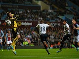 Tottenham's Jermain Defoe scores the opening goal against Aston Villa during their League Cup match on September 24, 2013