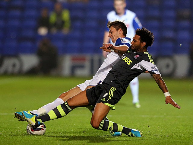 Stoke's Jermaine Pennant and Tranmere's Chris Atkinson battle for the ball during their League Cup match on September 25, 2013