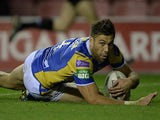 Leeds Rhino's Joel Moon scores his team's first try against Wigan Warriors on September 27, 2013