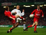 Juan Sebastian Veron attempts to keep possession from  Dietmar Hamann and John Arne Riise during the 2003 League Cup final.