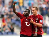 Mame Biram Diouf of Hannover celebrates scoring his team's first goal with Artur Sobiech of Hannover the Bundesliga match between Hannover 96 and 1. FSV Mainz 05 at HDI Arena on August 31, 2013
