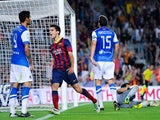 Barcelona's Marc Bartras celebrates after scoring his team's fourth goal against Real Sociedad during their La Liga match on September 24, 2013