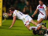 Sale Sharks' Mark Cueto score a try against Northampton Saints during their Aviva Premiership match on September 27, 2013