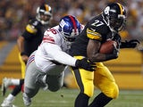 Marvin Austin #96 of the New York Giants tackles Jonathan Dwyer #27 of the Pittsburgh Steelers during the game on August 10, 2013