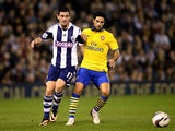 West Brom's Graham Dorrans and Arsenal's Mikel Arteta battle for the ball during their League Cup match on September 25, 2013