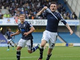 Scott Malone of Millwall celebrates after scoring the teams second goal during the Sky Bet Championship match between Millwall and Leeds United at The Den on September 28, 2013