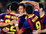 Barcelona's Neymar is congratulated by teammates after scoring the opening goal against Real Sociedad during their La Liga match on September 24, 2013