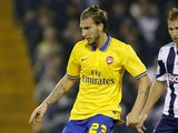 Arsenal's Danish striker Nicklas Bendtner vies with West Bromwich Albion's English defender Craig Dawson during the League Cup football match between West Bromwich Albion and Arsenal at The Hawthorns in West Bromwich on September 25, 2013