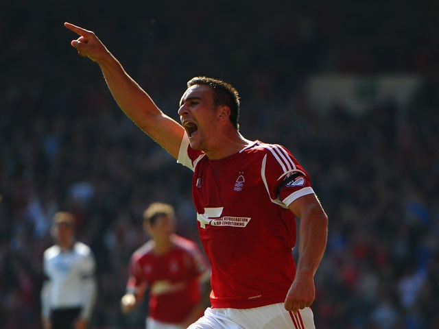 Jack Hobbs of Nottingham Forest celebrates scoring the opening goal during the Sky Bet Championship match between Nottingham Forest and Derby County at City Ground on September 28, 2013