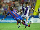 Real Valladolid's Omar Ramos and Levante's Papa Diop battle for the ball during their La Liga match on September 24, 2013