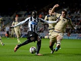 Newcastle's Papiss Cisse scores the opening goal against Leeds during their League Cup match on September 25, 2013