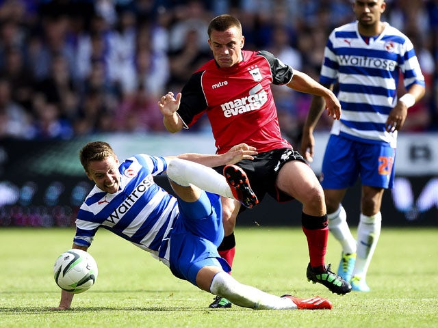 Paul Taylor of Ipswich battles with Chris Gunter of Reading during the Sky Bet Championship match between Reading and Ipswich Town at the Madejski Stadium on August 03, 2013