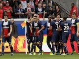 Paris Saint-Germain's players celebrate after Brazilian defender Marquinhos scored a goal during the French L1 football match between Paris Saint-Germain and Toulouse at the Parc des Princes Stadium in Paris on September 28, 2013