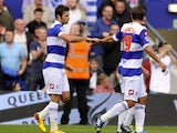 Charlie Austin of Queens Park Rangers celebrates with his teammates after scoring a goal from the penalty spot during the Sky Bet Championship match between Queens Park Rangers and Middlesbrough at Loftus Road on September 28, 2013