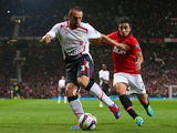 Man United's Rafael and Liverpool's Jose Enrique battle for the ball during their League Cup match on September 25, 2013