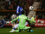 Chelsea's Ramires beats Swindon's Wes Foderingham to score his team's second goal during their League Cup match on September 24, 2013
