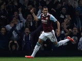 West Ham's Ravel Morrison celebrates after scoring the opening goal against Cardiff during their League Cup match on September 24, 2013