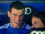 Gareth Bale of Real Madrid CF sits on the bench as he speaks with team-mate Luka Modric prior to start the La Liga match between Real Madrid CF and Club Atletico de Madrid at Estadio Santiago Bernabeu on September 28, 2013