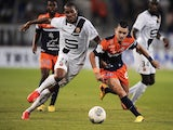 Montpellier's Remy Cabella vies with Rennes' forward Abdoulaye Sane during a match on September 26, 2013