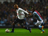 Tottenham's Sandro and Villa's Yacouba Sylla battle for the ball during their League Cup match on September 24, 2013