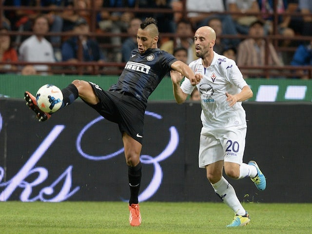 Saphir Taider of FC Inter Milan and Borja Valero of ACF Fiorentina compete for the ball during a match on September 26, 2013