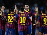 Barcelona's Sergio Busquets is congratulated by teammates after scoring his team's third goal against Real Sociedad during their La Liga match on September 24, 2013