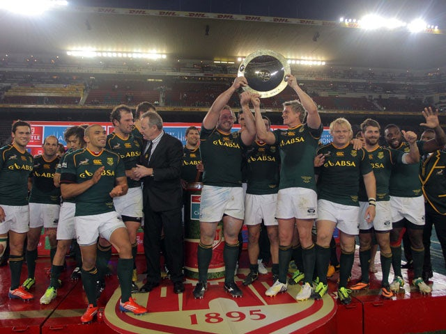 Springbok players celebrate their win during The Rugby Championship match between South Africa and Australia at DHL Newlands Stadium on September 28, 2013