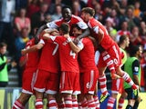 Rickie Lambert of Southampton is surrounded by team mates after scoring during the Barclays Premier League match between Southampton and Crystal Palace at St Mary's Stadium on September 28, 2013