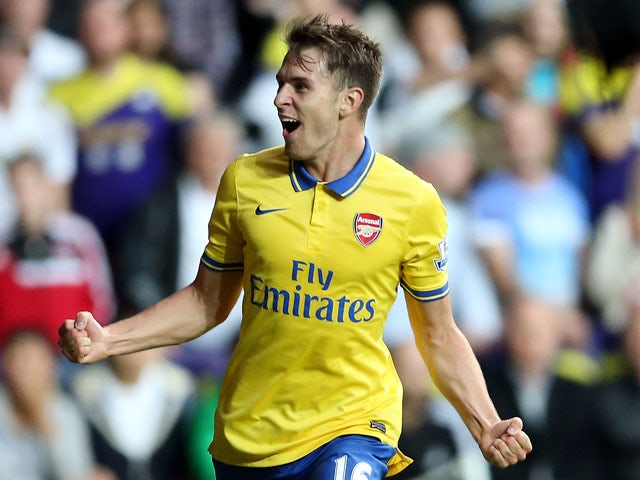 Aaron Ramsey celebrates after scoring their second goal during the Barclays Premier League match between Swansea City and Arsenal at Liberty Stadium on September 28, 2013