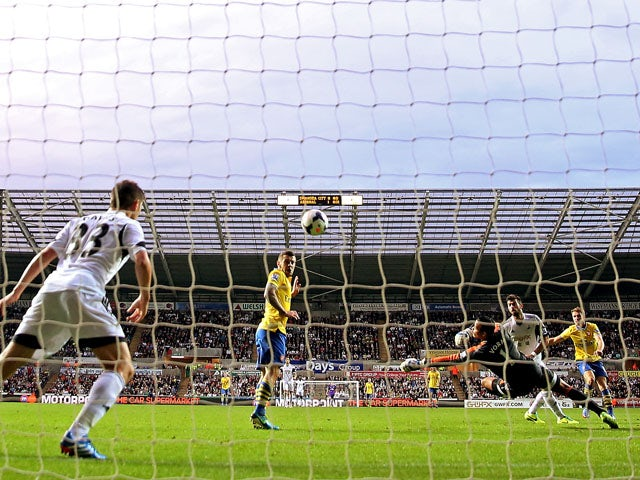 Aaron Ramsey of Arsenal scores their second goal during the Barclays Premier League match between Swansea City and Arsenal at Liberty Stadium on September 28, 2013