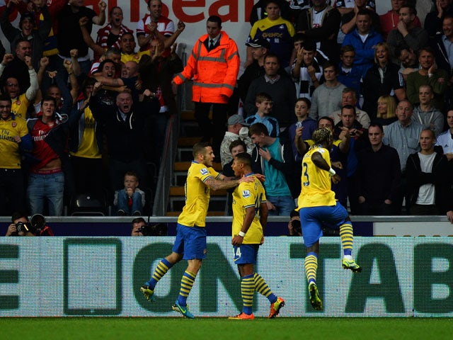 Arsenal's German forward Serge Gnabry celebrates scoring during a goal during the English Premier League football match between Swansea City and Arsenal at the Liberty Stadium in Swansea on September 28, 2013