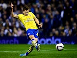 Arsenal's Thomas Eisfeld scores the opening goal against West Brom during their League Cup match on September 25, 2013