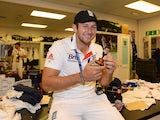 Tim Bresnan of England poses with the urn in the dressing room after winning the Ashes during day five of the 5th Investec Ashes Test match between England and Australia at the Kia Oval on August 25, 2013