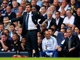 Andre Villas-Boas manager of Tottenham Hotspur signals as Jose Mourinho manager of Chelsea looks on during the Barclays Premier League match between Tottenham Hotspur and Chelsea at White Hart Lane on September 28, 2013