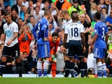 Fernando Torres of Chelsea is shown the red card by referee Mike Dean and is sent off during the Barclays Premier League match between Tottenham Hotspur and Chelsea at White Hart Lane on September 28, 2013