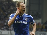 Chelsea's English defender John Terry celebrates after scoring a goal during the English Premier League football match between Tottenham Hotspur and Chelsea at White Hart Lane in London on September 28, 2013