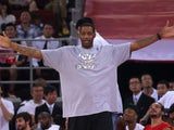 NBA star Tracy McGrady watches the Yao Foundation Charity Game, sponsored by the charity foundation initiated by former Chinese basketball star Yao Ming, during the 2013 Yao Foundation Charity Game between China team and the NBA Stars team on July 1, 2013