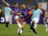 Massimo Ambrosini and Borja Valero of ACF Fiorentina competes for the ball with Luis Pedro Cavanda of Lazio during the Serie A match on October 6, 2013