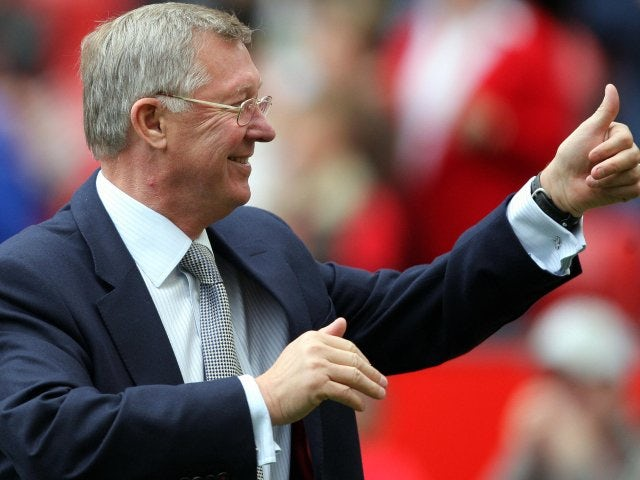 Sir Alex Ferguson waves to the Manchester United crowd after his victory over Wigan Athletic in October 2007.