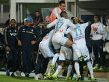 Marseille players celebrate following a goal by Andre Ayew during the French Ligue 1 match against PSG on October 6, 2013