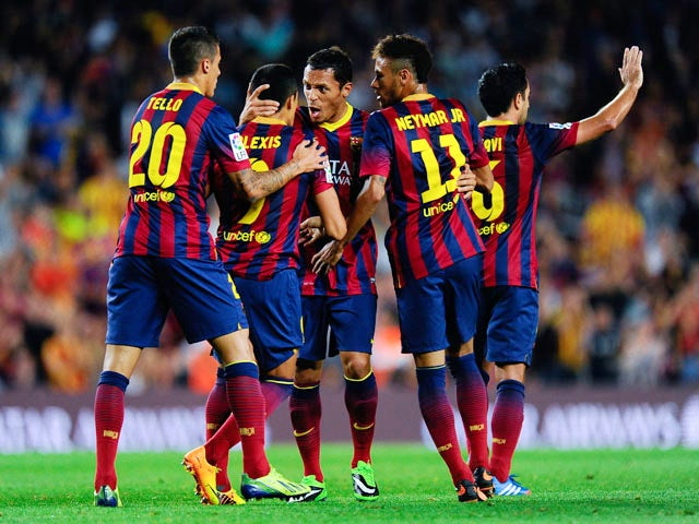 Alexis Sanchez of FC Barcelona celebrates with his team-mates after scoring his team's first goal during the La Liga match between FC Barcelona and Real Valladolid CF at Camp Nou on October 5, 2013