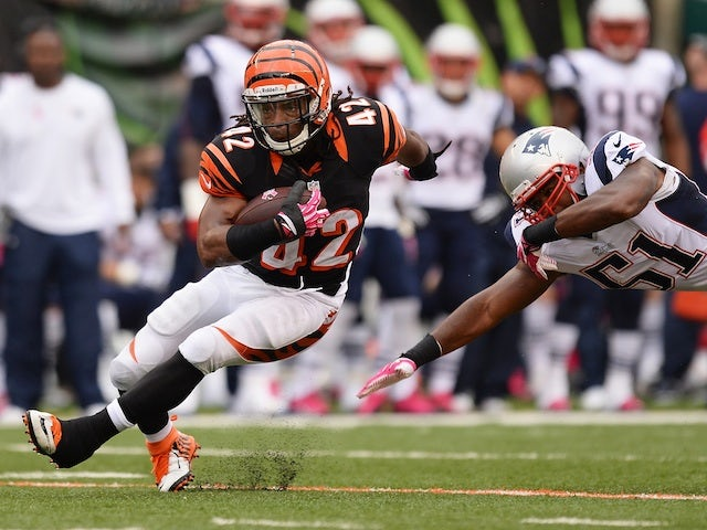BenJarvus Green-Ellis of the Cincinnati Bengals breaks a tackle attempt from Jerod Mayo of the New England Patriots during the match on October 6, 2013