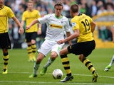 Moenchengladbach's striker Max Kruse and Dortmund's midfielder Kevin Grosskreutz vie for the ball during the German first division Bundesliga football match Borussia Moenchengladbach vs Borussia Dortmund in the western German city of Moenchengladbach on O