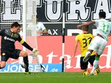 Moenchengladbach's Brazilian midfielder Raffael scores past Dortmund's goalkeeper Roman Weidenfeller and Dortmund's defender Erik Durm during the German first division Bundesliga football match Borussia Moenchengladbach vs Borussia Dortmund in the western