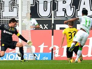 Moenchengladbach's Brazilian midfielder Raffael scores past Dortmund's goalkeeper Roman Weidenfeller and Dortmund's defender Erik Durm during the German first division Bundesliga football match Borussia Moenchengladbach vs Borussia Dortmund in the western