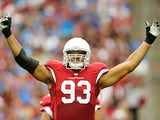 Calais Campbell works the crowd during the game between Arizona and Detroit on September 15, 2013